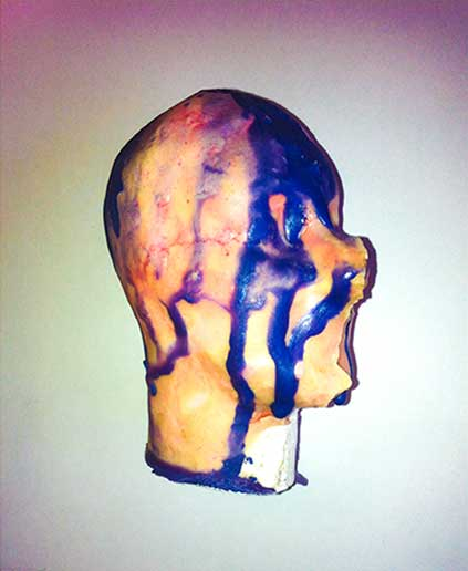 3d Plaster cast dolls head with melted wax crayon